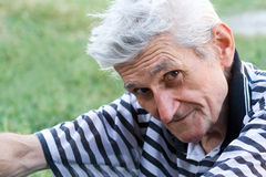 Outdoor portrait of calm serene senior man Stock Photo