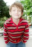 Outdoor portrait of child boy making faces Stock Images