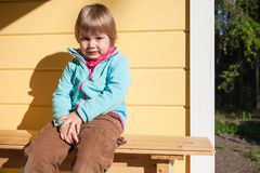 Outdoor portrait of confused Caucasian blond girl Royalty Free Stock Images