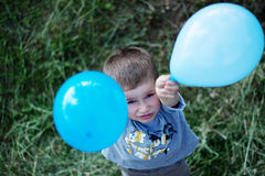 Outdoor portrait of cute boy with balloons Stock Photo
