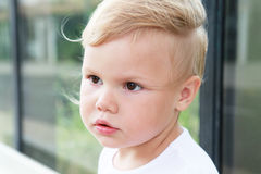 Outdoor portrait of cute Caucasian blond baby girl Stock Images