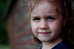 Outdoor portrait of cute girl. Portrait of cute girl near brick wall Royalty Free Stock Photography