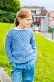 Outdoor portrait of a cute little girl Stock Photos