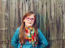 Outdoor portrait of a cute little girl in glasses Royalty Free Stock Images
