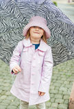 Outdoor portrait of a cute little girl in glasses Royalty Free Stock Photo