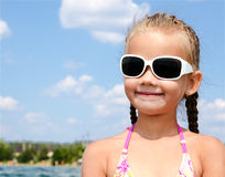 Outdoor portrait of cute little girl looking away Royalty Free Stock Images