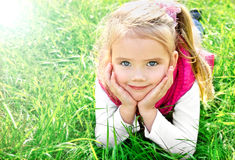 Outdoor portrait of cute little girl Stock Image