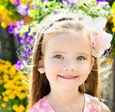 Outdoor portrait of cute little girl near the flowers Royalty Free Stock Photography