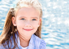 Outdoor portrait of cute little girl near the sea Royalty Free Stock Image