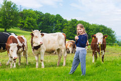Outdoor portrait of a cute little girl. Cute little girl resting on a farm in summertime Stock Photography