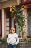 Outdoor fashion portrait of cute preteen girl. Outdoor portrait of cute little girl wearing grey pullover Stock Image