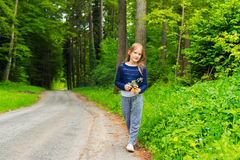 Outdoor portrait of a cute little girl Stock Photos
