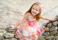 Outdoor portrait  of cute sitting little girl Royalty Free Stock Images