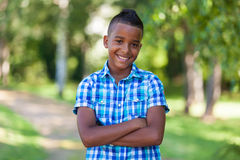 Outdoor portrait of a cute teenage black boy - African people Royalty Free Stock Photography