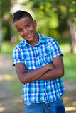 Outdoor portrait of a cute teenage black boy - African people Royalty Free Stock Photo