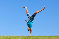 Outdoor portrait of a cute teenage black boy jumping Stock Photos