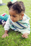Outdoor portrait of a cute young black baby girl Stock Photo