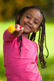 Outdoor portrait of a cute young black girl - African people Stock Photo