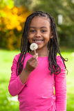 Outdoor portrait of a cute young black girl - African people Royalty Free Stock Images