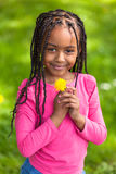 Outdoor portrait of a cute young black girl - African people Stock Image