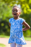 Outdoor  portrait of a cute young black girl - African people Royalty Free Stock Photo