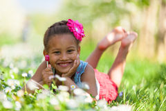 Outdoor portrait of a cute young black girl smiling - African pe Stock Images