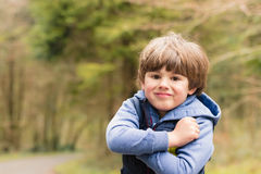 Outdoor portrait of cute young boy Royalty Free Stock Image