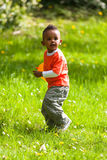 Outdoor portrait of a cute young  little black boy playing with Royalty Free Stock Photo