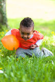 Outdoor portrait of a cute young  little black boy playing with Stock Photography