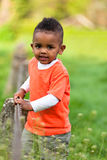Outdoor portrait of a cute young  little black boy playing outsi Royalty Free Stock Image