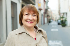 Outdoor portrait of european mature woman Stock Image