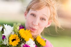 Outdoor Portrait of an Excited Young Adult Brown Eyed Woman Hold stock images