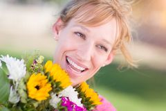 Outdoor Portrait of an Excited Young Adult Brown Eyed Woman Hold stock photo