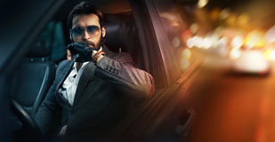 Outdoor portrait of fashion man driving a car Stock Image