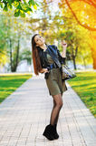 Outdoor portrait of fashionable pretty woman posing in a park Royalty Free Stock Image