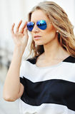 Outdoor portrait of fashionable young woman in sunglasses - clos Royalty Free Stock Image
