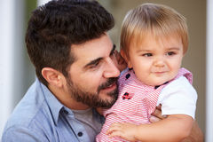 Outdoor Portrait Of Father Holding Son Royalty Free Stock Photos
