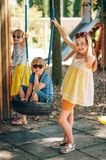 Outdoor portrait of 3 funny kids. Playing together in summer park. Happy childhood Stock Photo