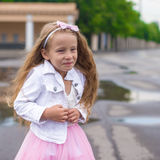 Outdoor portrait of funny little girl in princess Royalty Free Stock Photos