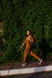 Outdoor portrait of girl in sport costume walking city streets Stock Images