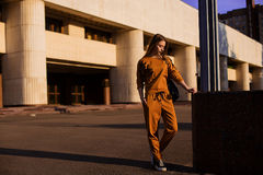 Outdoor portrait of girl in sport costume walking city streets Royalty Free Stock Photo