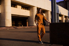 Outdoor portrait of girl in sport costume walking city streets Stock Photography