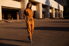 Outdoor portrait of girl in sport costume walking city streets Royalty Free Stock Photography