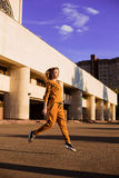Outdoor portrait of girl in sport costume walking city streets Royalty Free Stock Photos