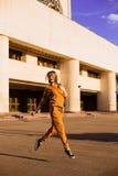Outdoor portrait of girl in sport costume walking city streets Stock Photo