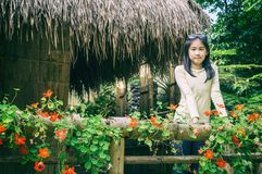 outdoor portrait of girl standing on atched bamboo thai traditio Royalty Free Stock Images