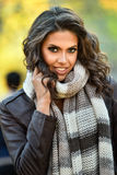 Outdoor portrait of glamour young model in the autumn park. Royalty Free Stock Image