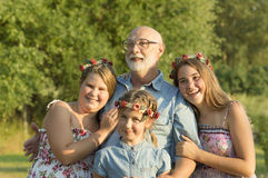 Outdoor portrait of  grandfather with granddaughters. Royalty Free Stock Image