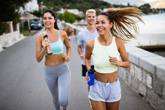 Outdoor portrait of group of friends running and jogging in nature stock photos