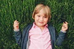 Outdoor portrait of handsome little boy stock image